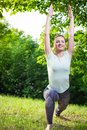 Young woman exercising outdoors in nature Royalty Free Stock Photo