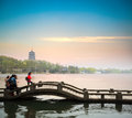Beautiful hangzhou scenery at dusk west lake in zigzag bridge and pagoda in sunset china Royalty Free Stock Images