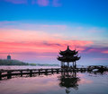 Beautiful hangzhou in sunset ancient pavilion silhouette on the west lake china Stock Images