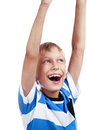 Beautiful happy blond boy raising his hands upwards dancing and laughing isolated on white background Stock Photo