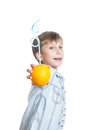 Beautiful happy boy in blue shirt shows an orange with a straw smiling stretching healthy life concept Royalty Free Stock Photos