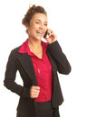 Beautiful happy business woman talking on cellphone isolated white candid waist up vertical shot Royalty Free Stock Photo