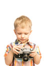 Beautiful happy child little boy holding old photo camera his hands isolated white background Royalty Free Stock Photo
