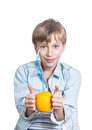 Beautiful happy child in stylish shirt holds an orange with a straw shows smiling healthy life concept Royalty Free Stock Photography