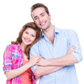 Beautiful happy couple in casual looking at camera on white background Stock Images