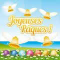 Beautiful and colorful French Happy Easter greeting card II with easter eggs and bells. Royalty Free Stock Photo