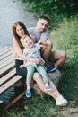 Beautiful happy family having picnic near lake Royalty Free Stock Photo