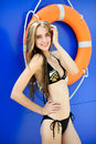 Beautiful happy female model posing by the pool outdoor portrait Stock Photo