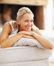 A beautiful happy female resting at home Stock Images