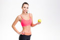 Beautiful happy fitness girl holding an apple Royalty Free Stock Photo