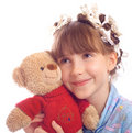 The beautiful happy girl embraces a toy bear Royalty Free Stock Image