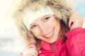Beautiful happy girl in the hood winter outdoors Royalty Free Stock Photo