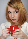 Beautiful happy girl with a red cup Royalty Free Stock Photo