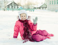 Beautiful happy girl in the red jacket waving his hand welcoming winter outdoors Royalty Free Stock Photo