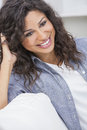 Beautiful happy hispanic woman smiling studio portrait of a young latina Royalty Free Stock Photos