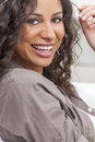 Beautiful happy hispanic woman smiling studio portrait of a young mixed race latina Royalty Free Stock Photography