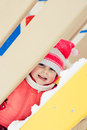 Beautiful happy kid in the red warm clothing winter outdoors Stock Image