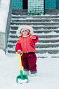Beautiful happy kid in the red warm clothing winter outdoors Stock Photography