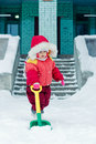 Beautiful happy kid in the red warm clothing winter outdoors Royalty Free Stock Image