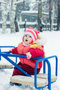 Beautiful happy kid in the red warm clothing winter outdoors Royalty Free Stock Photos