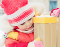 Beautiful happy kid in the red warm clothing winter outdoors Royalty Free Stock Photography
