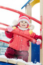Beautiful happy kid in the red warm clothing winter outdoors Stock Photo