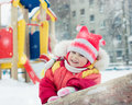 Beautiful happy kid in the red warm clothing winter outdoors Royalty Free Stock Images
