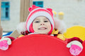 Beautiful happy kid in the red warm clothing winter outdoors Stock Photos