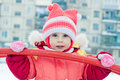 Beautiful happy kid in the red warm clothing winter outdoors Stock Images