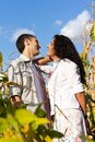 Beautiful happy love couple  against blue sky Royalty Free Stock Photography