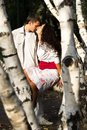Beautiful happy love couple in birches Royalty Free Stock Images