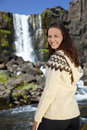 Beautiful Happy Scandinavian Woman By A Waterfall Stock Photo