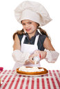 Beautiful happy seven year old girl in chef uniform with shortca Royalty Free Stock Photo
