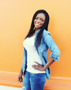 Beautiful happy smiling african woman wearing a jeans clothes Royalty Free Stock Photo