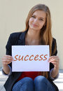 Beautiful,happy,smiling blonde girl with long beauty hair and the inscription,note Success. Royalty Free Stock Photo