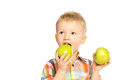 Beautiful happy smiling joyful child little boy eating healthy food green apples isolated white background Royalty Free Stock Photos