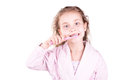 Beautiful happy smiling little girl brushing her teeth after bath, shower