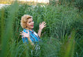 Beautiful happy surprised pinup girl in grass Stock Photography