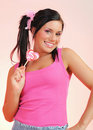 Beautiful happy teenage girl with a lollipop Stock Images