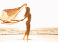 Beautiful happy woman on beach at sunset free relaxing walk the fashion lifestyle backlit warm sunny colors Royalty Free Stock Photo