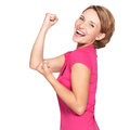 Beautiful happy woman celebrating success being a winner with икшпре expression isolated on white background Royalty Free Stock Images
