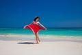 Beautiful happy woman dancing enjoying on exotic beach in summer Royalty Free Stock Photo