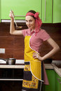 Beautiful happy woman in kitchen interior cooking Stock Image