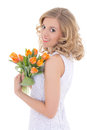 Beautiful happy woman with orange tulips isolated on white Stock Photo