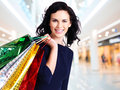 Beautiful happy woman with shopping bags. Stock Photo