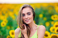 Beautiful happy woman with sunflowers outdoors Stock Photos