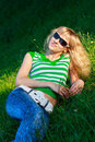 Beautiful happy woman in sunglasses the nature Royalty Free Stock Photo