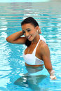 Beautiful happy woman in a swimming pool Royalty Free Stock Image