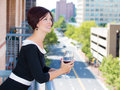 Beautiful happy woman, wife, executive relaxing on a summer day on a balcony of a new apartment Royalty Free Stock Photo
