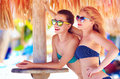 Beautiful happy women friends enjoy summer vacation on tropical beach two Royalty Free Stock Photos